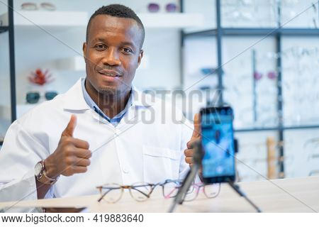 Ophthalmologist Doctor African American Entrepreneur Is Vlogger Or Blogger Show New Fashion Glasses