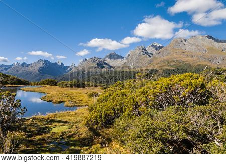 Alpine Lake At Key Summit Track In Fiordland National Park, South Island, New Zealand With Blue Sky