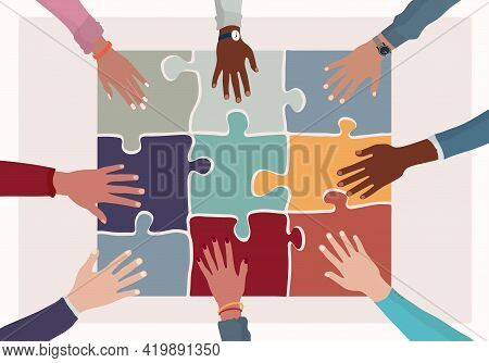 Agreement Or Affair Between A Group Of Colleagues Or Co-workers.hands Joining Puzzle Pieces On A Tab