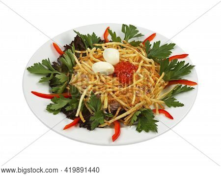 Russian Traditional Salad In The Form Of A Nest With Quail Eggs And Crispy Potatoes On White Plate I