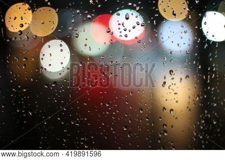 Drops Of Rain On The Window Beautiful Night View With Rainfall Rain Drops Of Rainfall On The Transpa