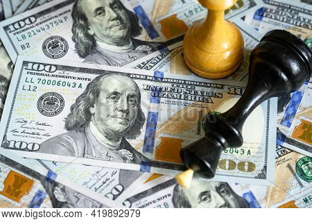 Chess Figures On Us Dollar Bills Pile, King Lies On Cash. American Banknotes And Game. Concept Of Tr