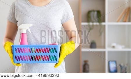 House Chores. Cleaning Day. Housewife Work. Unrecognizable Woman In Protective Gloves Holding Basket