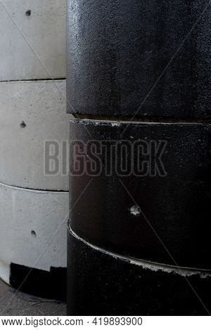 Reinforced Concrete Rings For The Construction Of Sewers And Wells, Outside. Gray And Tarred. Vertic