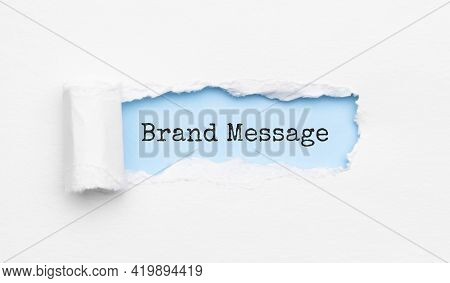 The Text Brand Message Appearing Behind Torn Yellow Paper