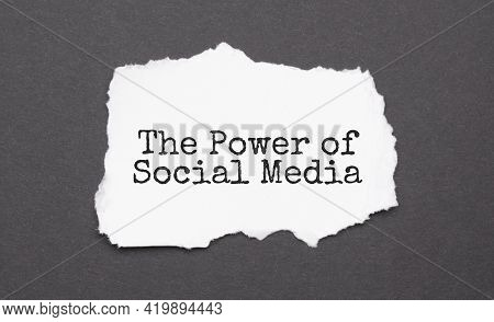 The Power Of Social Media Sign On The Torn Paper On The Black Background