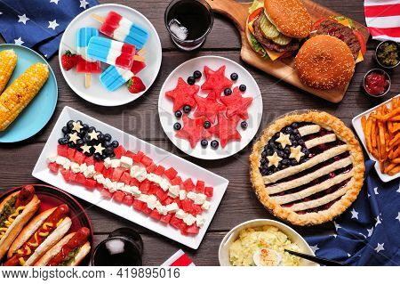 Fourth Of July, Patriotic, American Themed Food. Overhead View Table Scene On A Dark Wood Background