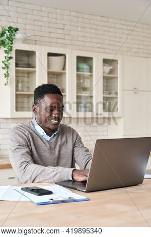 Adult Smiling Professional African American Black Student Business Man Sitting At Kitchen Table Work