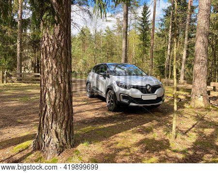 Grodno, Belarus-08.05.2021: Silver Crossover Renault Kaptur, Captur Stands In The Forest Between The