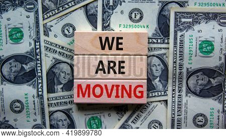 We Are Moving Symbol. Wooden Blocks With Words 'we Are Moving'. Beautiful Background From Dollar Bil