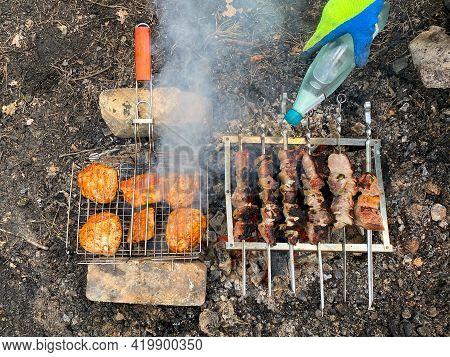 Roasts Pork Shish Kebab And Chicken Shish Kebab In Nature. Roasting Pork Skewers On Skewers And Roas