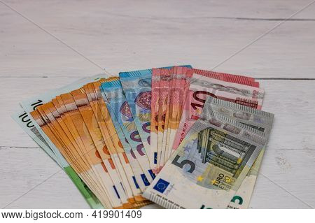 Selective Focus On Detail Of Euro Banknotes. Detail Of European Union Currency Euro Banknotes. World