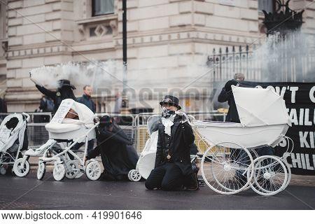 Westminster, London | Uk -  2021.05.08: Extinction Rebellion Activists Kneeling In Front Of Downing