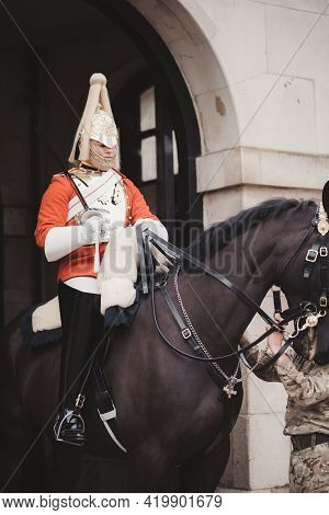 Westminster, London | Uk -  2021.05.08: Traditional Household Cavalry Guard In Full Uniform Outside