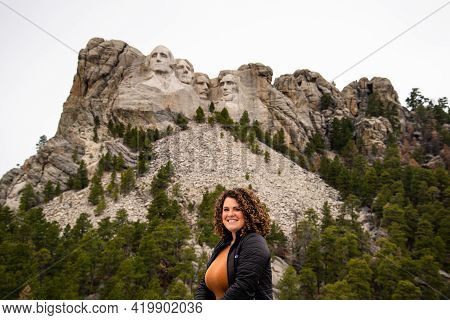 Keystone, South Dakota - April 25, 2021: Young Woman Standing In Front Of Mount Rushmore National Mo
