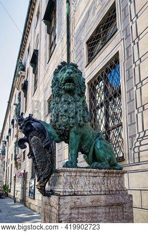 Bavarian Lion Statue At Munich Alte Residenz Palace In Odeonplatz. Munich, Bavaria, Germany. Munich