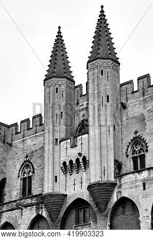 Stone Walls And Towers Of The Medieval Castle Of The Popes In The City Of Avignon In France, Monochr