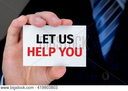 Business Man Show Card With Let Us Help You Text Support Concept
