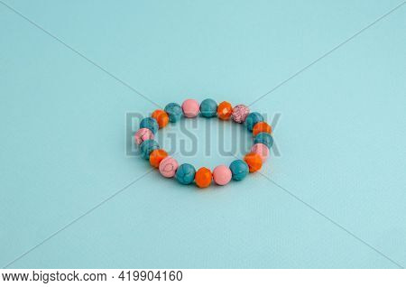 Bangle, Colored Beads Bracelet On A Clean Background