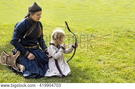 Minsk, City Holiday On September 8, 2018 ,two Archers, Mother And Daughter At The City Festival In M
