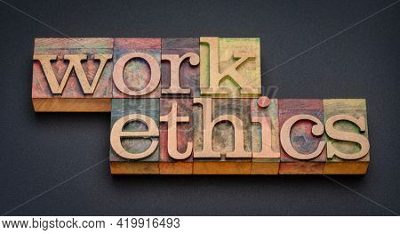 work ethics - word abstract in letterpress wood type stained by color inks against matte black background, professional integrity and business concept