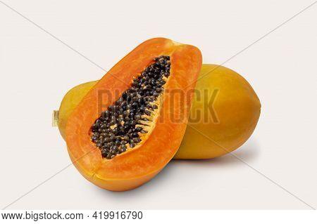 Ripe Papaya Fruit With Half Papaya Isolated On White Background.