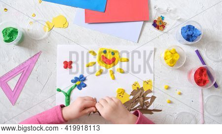Child Making Spring Card From Colorful Paper And Plasticine, Clay. Handmade. Concept Of Children's C