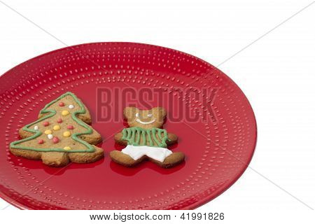 Gingerbread cookies on a red plate