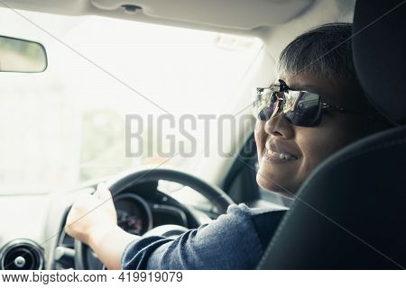 Happy On Trip Or Travel. Travel Asian Smart Seniors Woman Smiling Driving Car With Sunglasses. Holdi