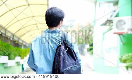 Back Of Young Asian Campus Student Man Wearing Protection Mask While Walking In Campus, Coronavirus
