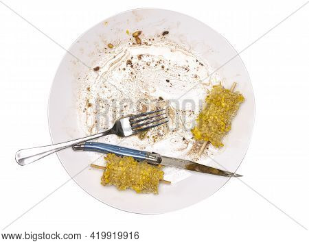 Eaten Meal With Sweetcorn With Knife Folk And Plate On A White Background