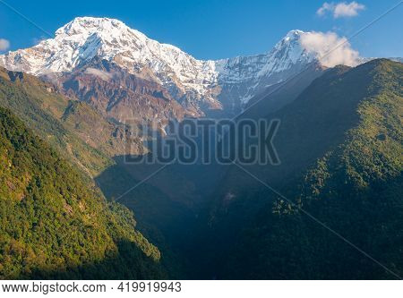 Beautiful View Of Mt.annapurna South And Mt.hiunchuli View From Chomrong Village On The Way To Annap