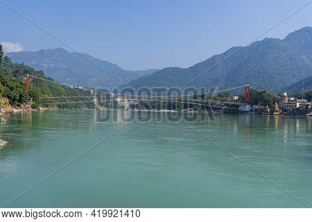 Laxman Jhula Bridge Over Ganges River In Rishikesh, India