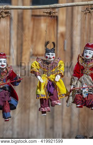 Colorful Puppets In A Tourist Stall On The Street Market In Burma. Souvenir Items For Sale In Myanma
