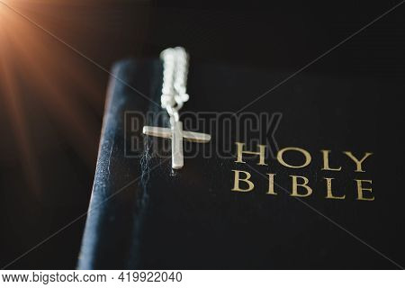 The Holy Bible On A Wooden Table.