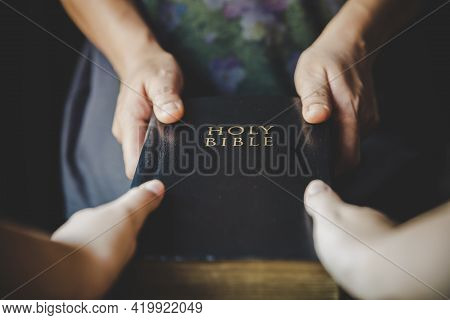 Woman Hands Giving Bible