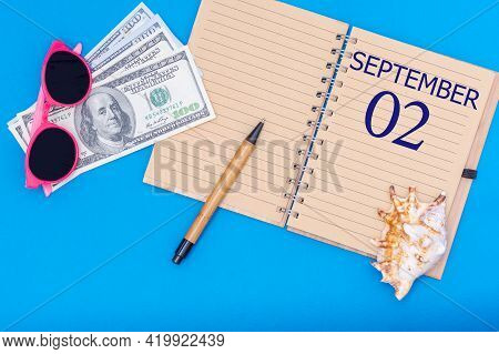 2nd Day Of September. Travel Concept Flat Lay - Notepad With The Date Of 2 September Pen, Glasses, D