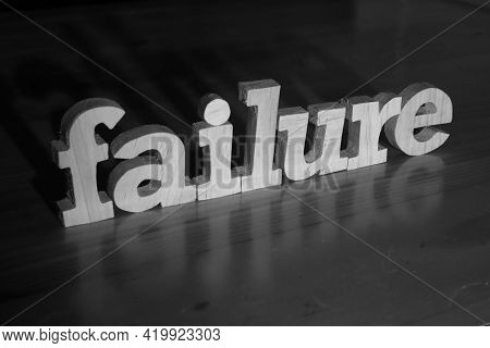 Failure, Text Words Typography Written With Wooden Letter On Black Background, Life And Business Neg