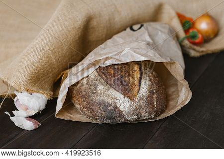 Crusty Sourdough Round Bread Made Of Whole Grain In Craft Package. Rural Style. Natural And Healthy