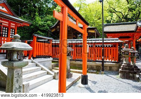 Fushimi Inari Taisha Shrine In Kyoto, Japan With Beautiful Red Gate And Japanese Garden. Red Torii G