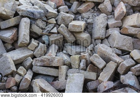 Ruins Of An Old House. A Pile Of Old Bricks After Dismantling An Old House.