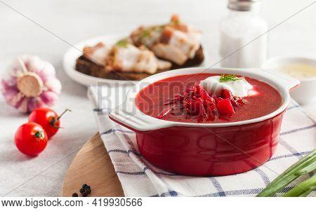 Delicious Fresh Red Borscht, Dark Bread With Lard And Salt On Kitchen Table.