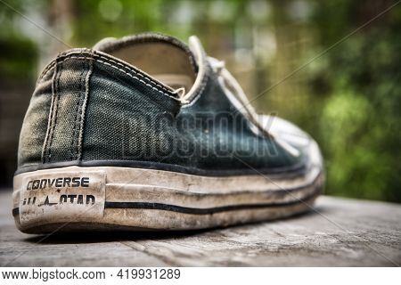 Antwerp, Belgium, May 2021: Illustrative Editorial: Outworn Converse All Star Chuck Taylor Shoe. Sel