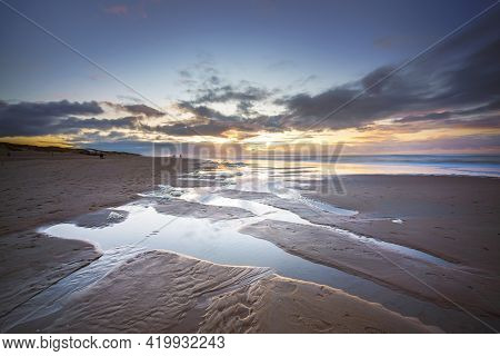 Maritime Landscape At Sunset With Reflection Of Clouds In Low Tide Water, Waddenzee, Texel, The Neth