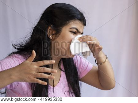 An Indian Asian Woman Sneezing An Facing Running Nose On White Background