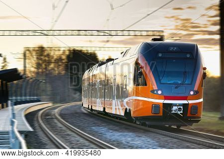Express Orange Train. Estonian New Train. Fast Light Intercity And Regional Train. Ecological Passen