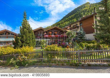 Houses Decorated With Flowers In Zermatt, Alpine Village, Switzerland, Summer Swiss Alps