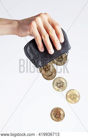 Isolated Image Of A Caucasian Woman Holding A Black Purse Against Bright White Background. Bitcoin C