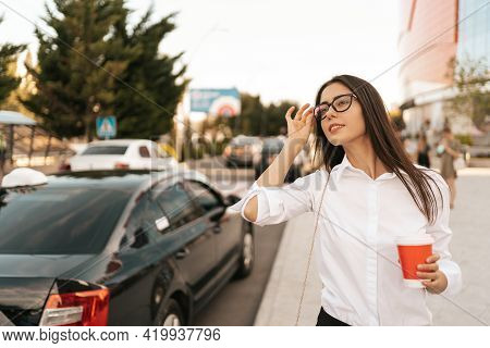 Attractive Businesswoman Watching To Call A Cab, Confident Trendy Dressed Female Manager Hailing On