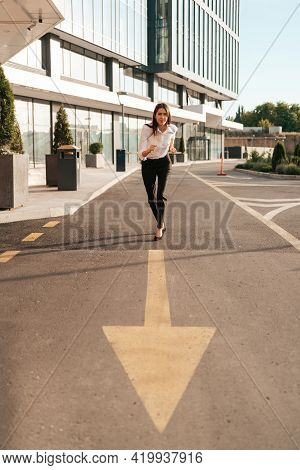 Businesswoman Standing Ready On Start Line With An Arrow In Front Before Race Or Sprint To Success